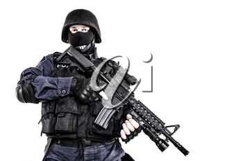 Special weapons and tactics SWAT team officer with his gun