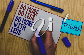 Conceptual hand writing showing Do More Do Less Do More With Less. Business photo text dont work hard work smart be unique Man holding marker paper clothespin express ideas wooden table