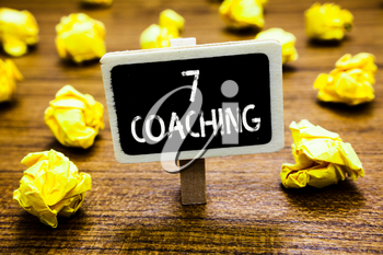 Conceptual hand writing showing 7 Coaching. Business photo showcasing Refers to a number of figures regarding business to be succesful Blackboard crumpled paper mistake not satisfied wooden floor