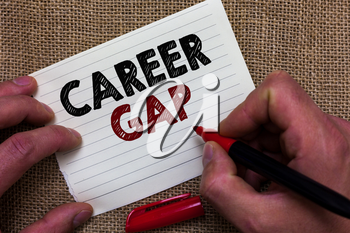 Writing note showing Career Gap. Business photo showcasing A scene where in you stop working by your profession for a while Man's hand hold white paper with symbolic letter jute sack background