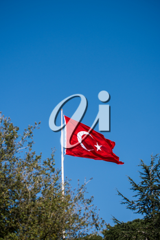 Turkish national flag hang on a pole in open air