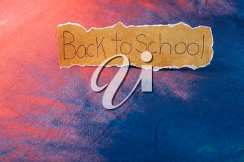 Back to school wording on a piece of torn paper