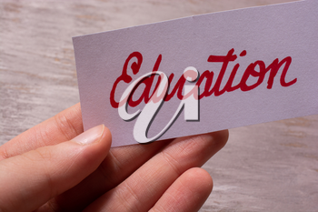 Word education hand written on white paper