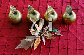 Golden apples and plastic flower. Christmas vintage decorative objects.