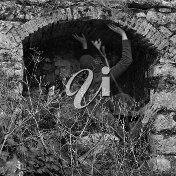 Obscured figures in arched abandoned structure. Double exposure black and white.
