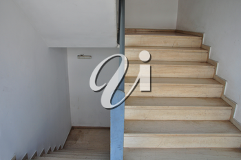 Stairway with marble steps. Abstract architectural detail.