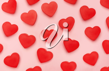 Flat view of valentines hearts  on pink background. Symbol of love and Saint Valentine's Day concept.