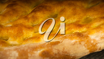 Schiacciata all'olio is one of Tuscany's top bakery treats. It's a type of flat bread made with flour, water, yeast, salt and olive oil. Seolective focus