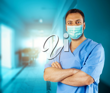Portrait of a nurse, or doctor, in hospital wearing surgical mask.