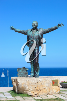 Polignano a Mare, Italy - August 15, 2014: Statue of the Italian singer and songwriter Domenico Modugno famous for the song Volare was born in Polignano.The author of the sculpture is Herman Mejer