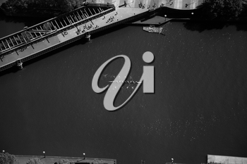 Top view of a dragon boat on the Yarra river in Melbourne in black and white